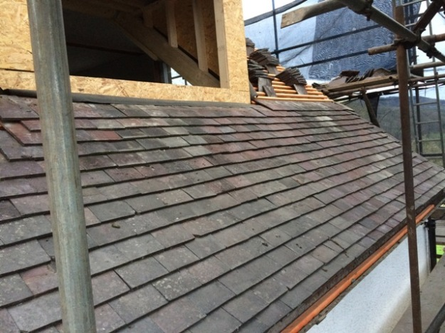 tiles-are-now-being-put-on-the-new-right-side-of-the-house