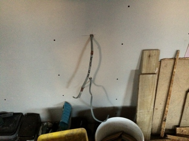 wiring-for-plug-sockets-at-front-of-new-bedroom-inserted-through-newly-installed-plasterboard