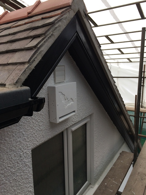 bat box at the top of the house under the gable