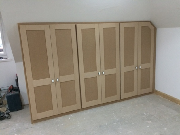 Cupboards built into sloping roof