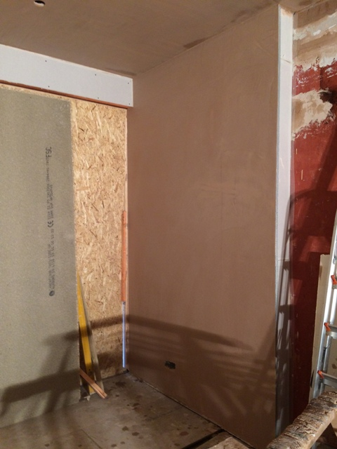 Freshly plastered wall of sun lounge, boarded area will have french doors