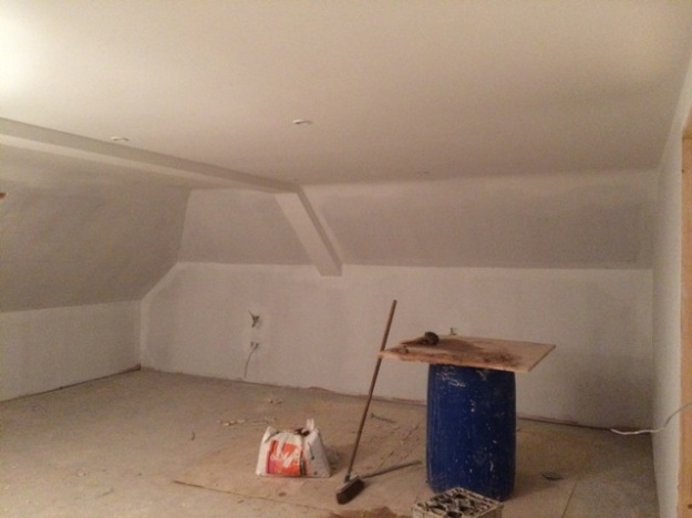 Initial coats of emulsion in new bedroom