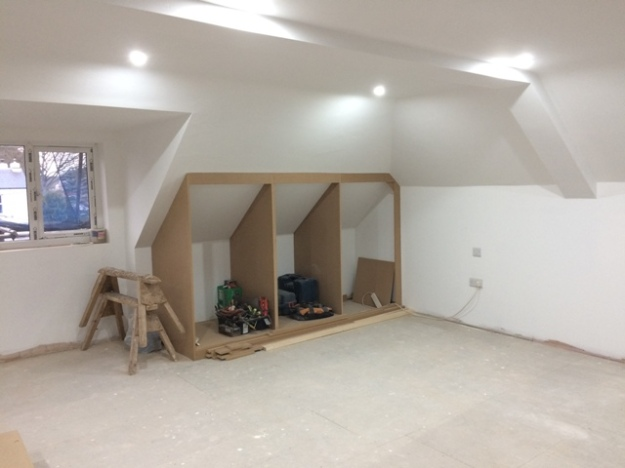 New fitted cupboards under construction in the sloping roof area