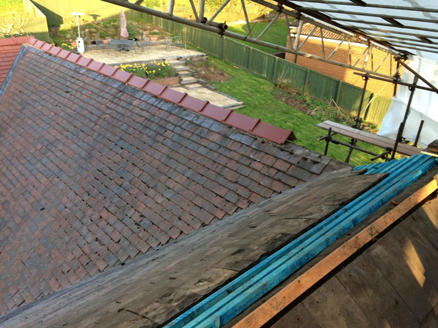 new ridge tiles from new kitchen extension and back bedroom to the very original old part of the house