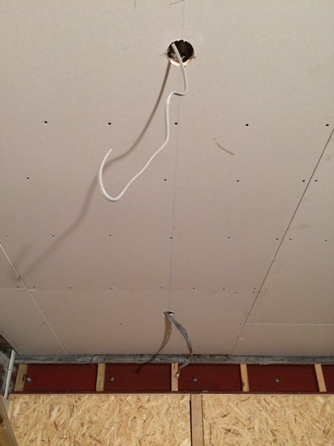Newly plasterboarded ceiling and wiring for new lights. There will be 8 in total in this room