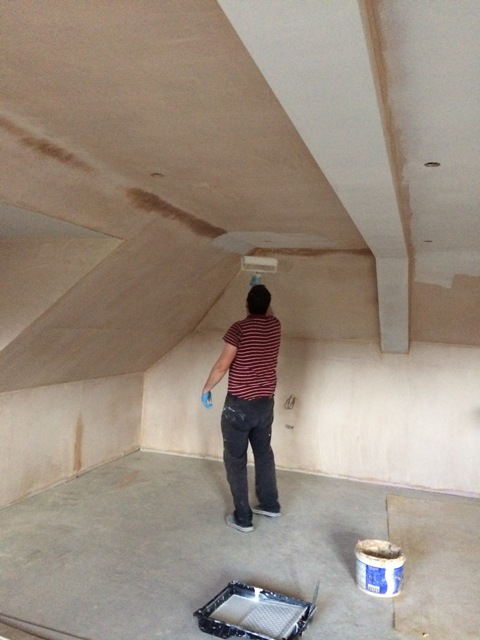 Paul putting on the first coat of emulsion in the new bedroom
