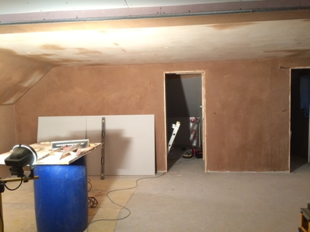 plastering-continues-upstairs-in-the-new-bedroom-view-over-to-staircase-through-lefthand-doorway-and-to-ensuite-through-right-hand-doorway