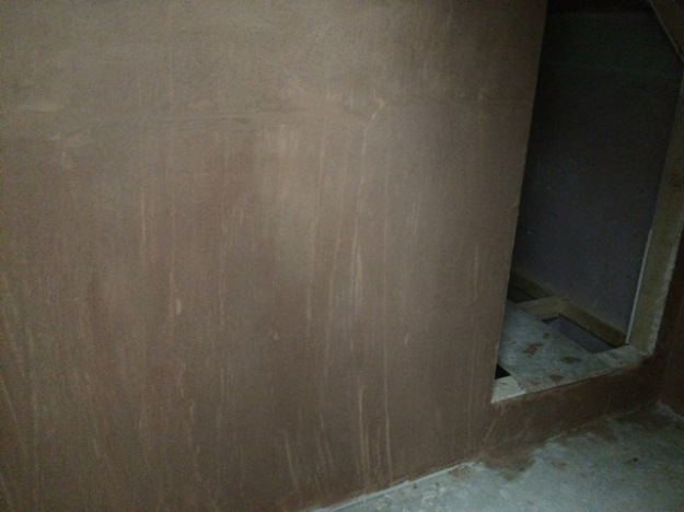 plastering in the new study around the newly created cupboard