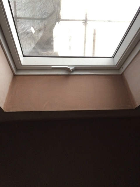 plastering in the new study around the velux window