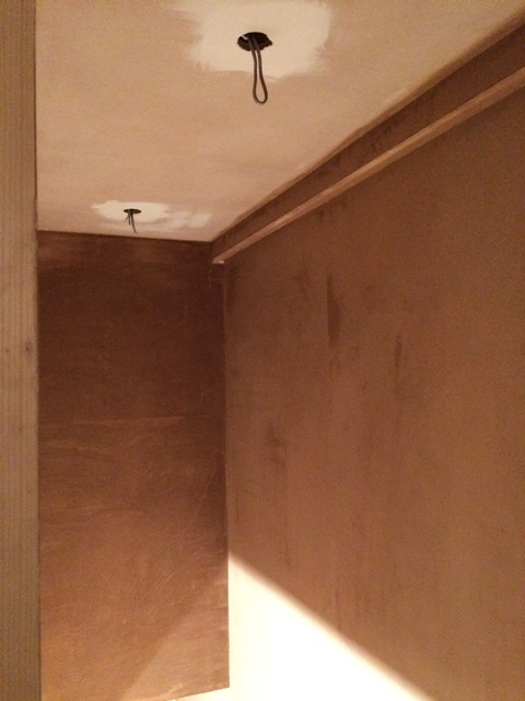 Plastering over the stairwell and wiring completed for stair lights
