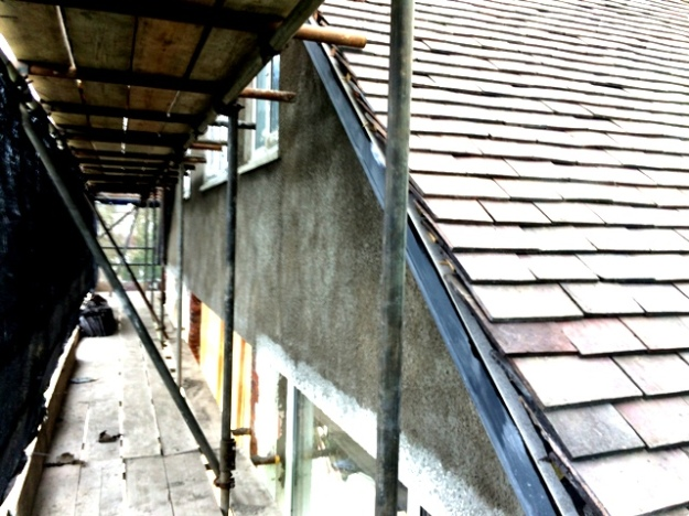 Roughcasting coat on outside of new upstairs extension
