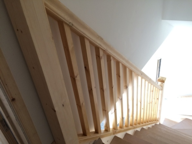 Stair rail now with spindles all stained and treated, the rest to complete after work is complete upstairs