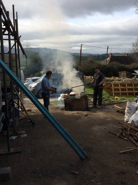 Steve and Luke burning the old roof battens