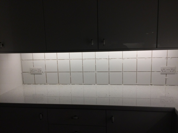 Tiles above cooker before being grouted