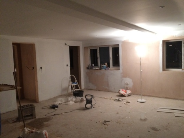 View across the new bedroom to windows, lights and wiring can be seen