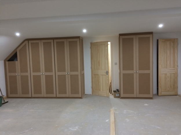 View of new wardrobes from dormer side of bedroom, corner not yet complete