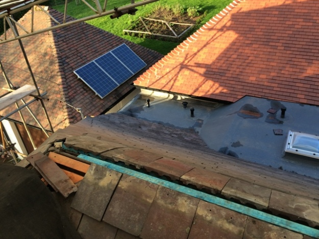 View over the flat roof of the utility and progress of the retiling
