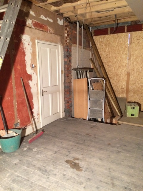 View towards the old porch, this room will be the new sun lounge, old red paint from years gone by