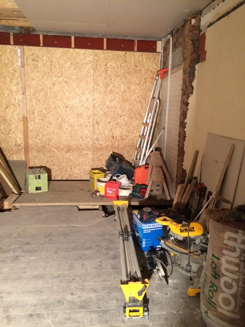Wooden beam framework in old porch area to create a new floor which will be level with the old hall dining room.