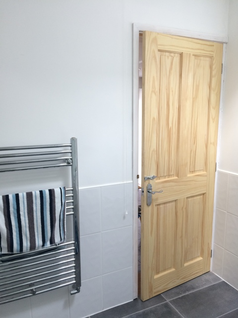door into new family bathroom now varnished on both sides