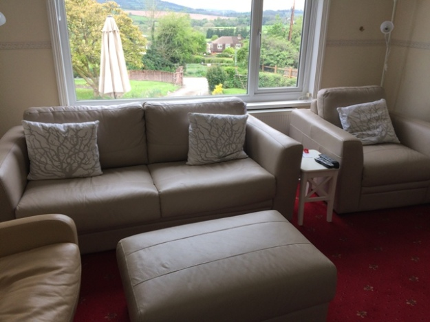 new sofabed in small sitting room and matching chair