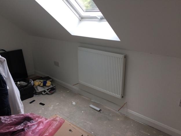 radiator in study beneath the velux window
