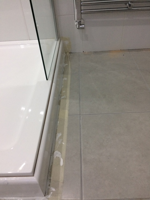 skirting board around shower base painted and glossed pic 2