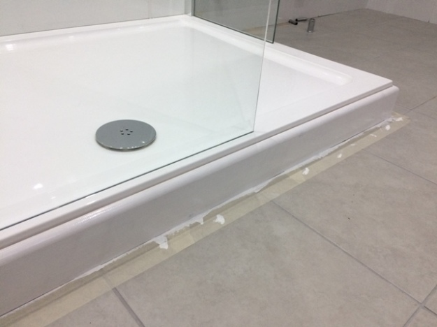 skirting board around shower base painted and glossed