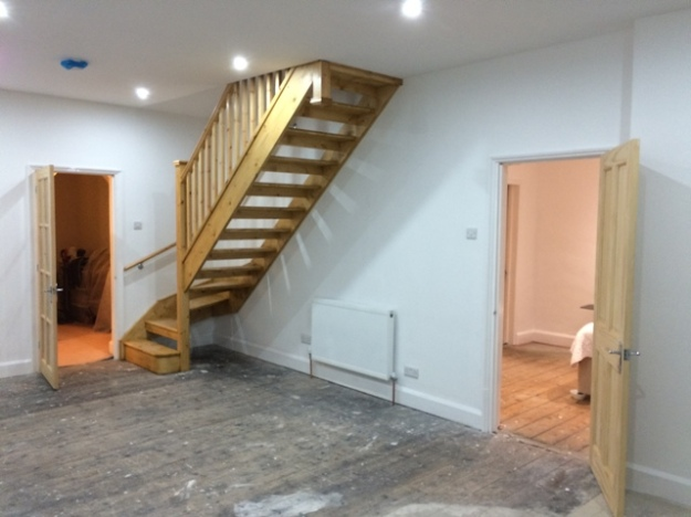 Sun lounge ready for carpet laying picture 3 showing staircase
