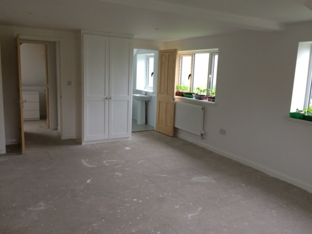 Upstairs bedroom ready for carpet - view through to ensuite