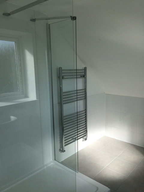 View of shower area and towel radiator