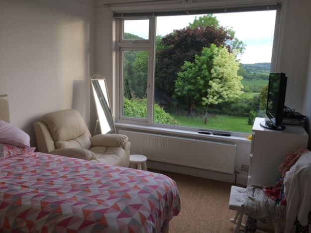Downstairs bedroom carpeted and furniture all back in place and view to front